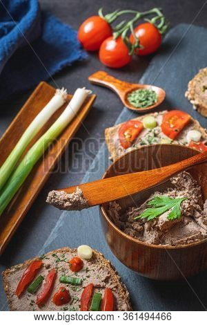 Homemade Rustic Pate On Bitten Slice Of Bread With Fresh Vegetables