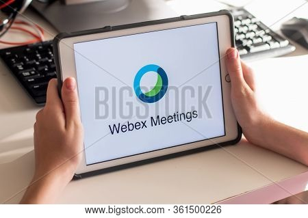 Sydney, Australia - 2020-04-15 Hands Holding A Smart Phone With Webex Cloud Meetings Application