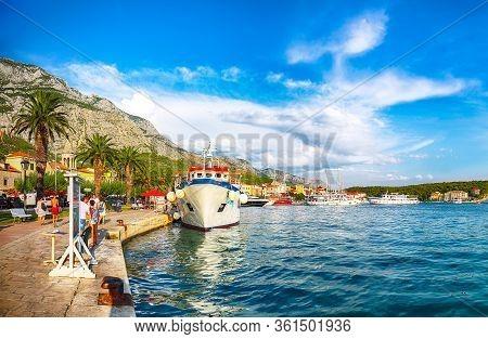 Famous Adriatic Resort Makarska With Picturesque Harbor And Touristic Boats. Location: Makarska Rivi