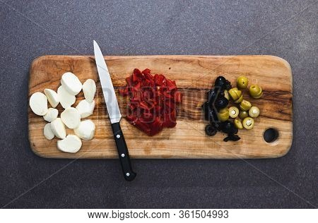 Healthy Food Ingredients Concept, Chopping Board With Pizza Topping Ingredients Chopped Up Including