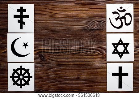 World Religions Concept. Christianity, Catholicism, Buddhism, Judaism, Islam Symbols On Wooden Backg