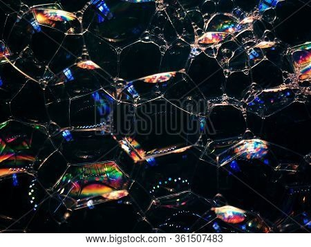 Soap Bubbles On Dark Background. Noise Film Grain So Conceived, Background Texture