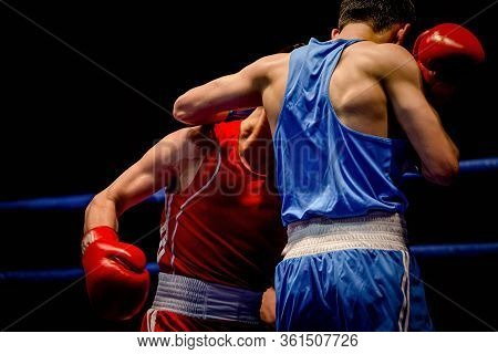 Boxing Match Two Boxers In Ring On Black Background