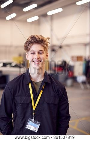 Portrait Of Male Student Studying For Auto Mechanic Apprenticeship At College