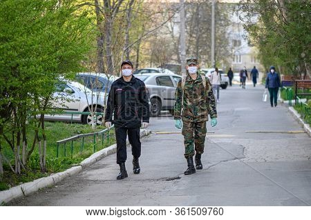 Chisinau, Moldova - April 04, 2020: mixed carabineri and military patrol in residential area of Chisinau, Moldova during covid-19 virus infection threat