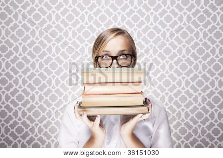 Woman Peering Over Books