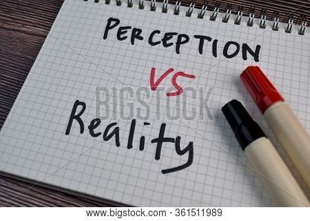 Perception Or Reality Write On A Book Isolated On The Table.
