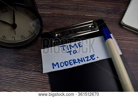 Time To Modernize Write On Sticky Notes Isolated On The Table.