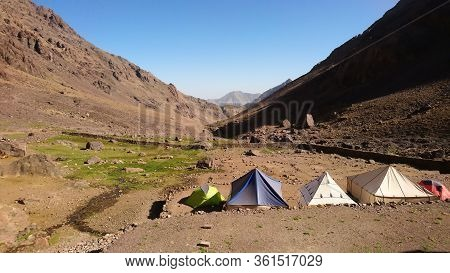 Imlil/morocco - 09.30.2019: Camping Spot With Tents In Front Of Refuge Toubkal Les Mouflons, In Atla