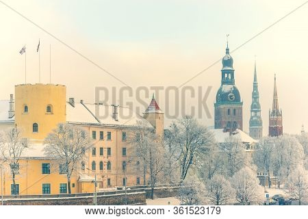 View Of The Latvian Presidential Palace And The Steeples Of The Cathedrals Against The Backdrop Of S