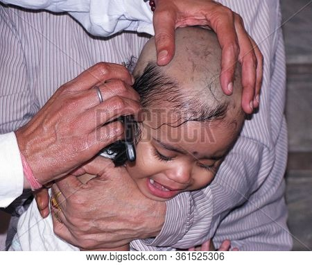 Delhi - India 10th May 2011 An Indian Infant Head Gets Shaven According To A Hindu Ritual Called As