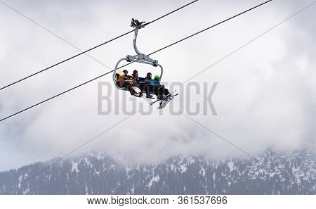Snowy Ski Slopes And Chair Ski Lifts Station In  Mountain Ski Resort.