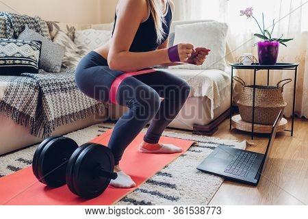 Home Workout During Coronavirus Quarantine. Woman Training Using Mat Sport Belt. Booty Glutes Buildi