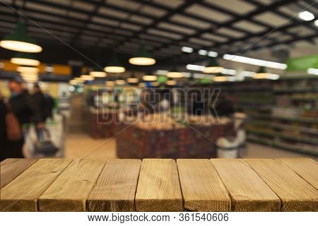Supermarket Background, Counter Over Blur Grocery Background, Wooden Desk, Table, Shelf And Blur Wom