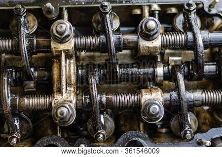 Detailed Shot Of A Carburetor Engine Without Valve Cover. Valves, Rocker Arms, Pushers And Springs.