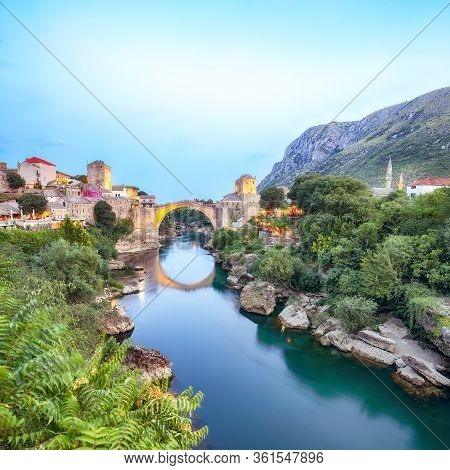 Majestic Evening View Of Mostar With The Mostar Bridge, Houses And Minarets, At Evening. Location: M