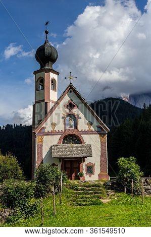 View Of St Johann Church, Santa Maddalena With Puez-geisler Dolomites Behind
