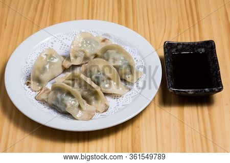 Chinese Food Called Steamed Shumay Dimsum On A White Dish