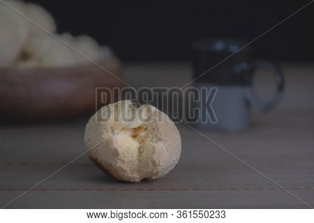 Closeup And Selective Focus On Mouth-watering Brazilian Cheese Bread (pao De Queijo) On Wooden Bowl,