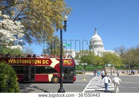 Washington DC / United States - April 27 2014:  A tour bus circa Capitol Grounds. US Capitol is one of the major tourist magnet especially during springtime in Washington DC.