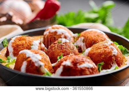 Malai Kofta Curry In Black Bowl. Malai Kofta Is Indian Cuisine Dish With Potato And Paneer Cheese De