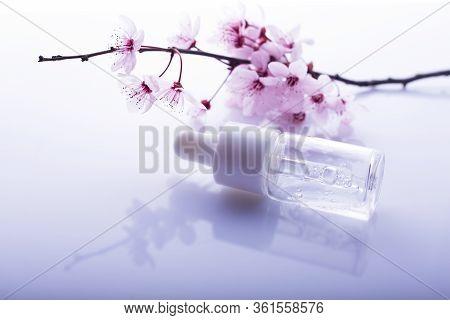 Hyaluronic Acid, Hydration Skin, Drops Bottle On Light Background