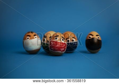 A Pack Of Eggs With Eyes And Masks On A Blue Background