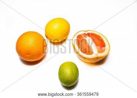 Lemon, Lime, Orange And Grapefruit On A White Background. Multiple Kinds Of Citric Together.