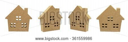 Group Of Wooden House Models Isolated On White Background.
