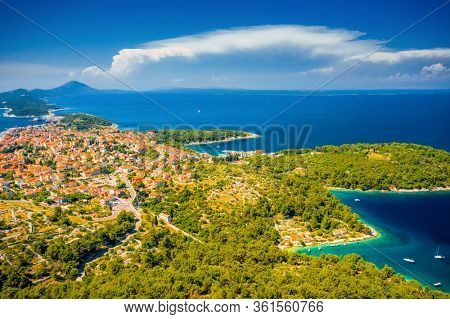 Old town Mali Losinj on Adriatic island under blue sky. Location place Kvarner gulf, Croatia, Europe. Popular touristic destination. Drone photography. Summer vacation. Discover the beauty of earth.