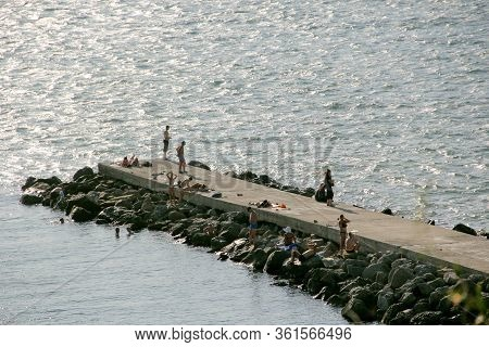 Anapa / August 27, 2019: People On The Beach On A Summer Day