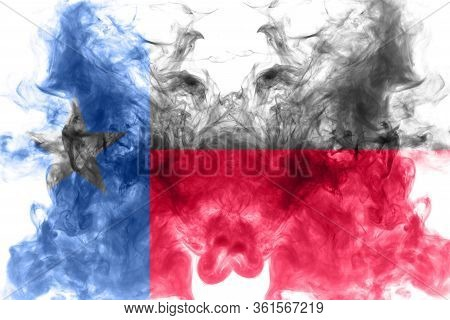 The National Flag Of The Us State Texas In Against A Gray Smoke On The Day Of Independence In Differ