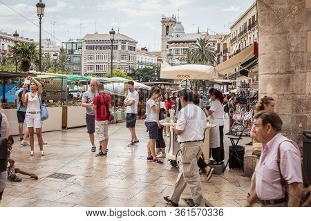 Valencia, Spain - June 16, 2017: Street Atmosphere On The Square Of Valencia Cathedral Where People