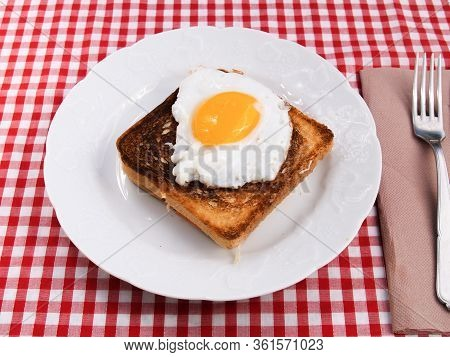 Croque-madame  Croque-madame A Traditional French Bread Sandwich With Grated Cheese And Ham Grilled
