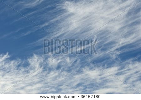 White Streaky Clouds In Blue Sky
