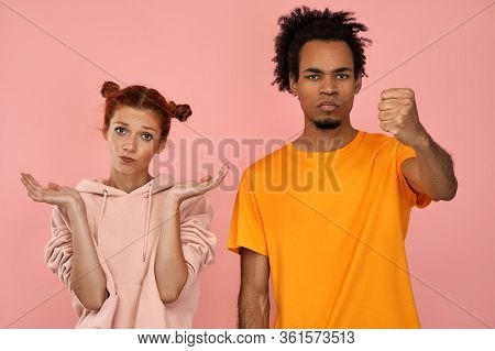 Questioned Doubtful Ginger Woman Spreads Palms Sideways, Has Unaware Facial Expression, Angry Dark-s