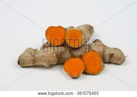 Fresh Turmeric Or Turmeric Root Isolated On A White Background Is Used As A Tonic For The Body And D