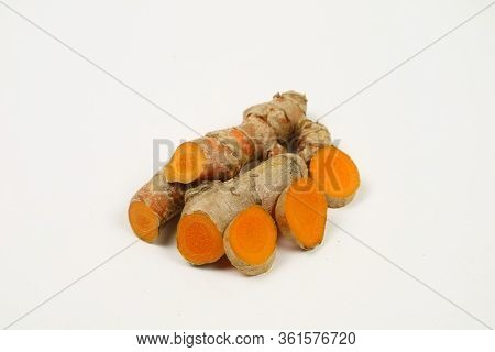 Fresh Turmeric Or Turmeric Root Isolated On A White Background.it Is Used As A Tonic For The Body An