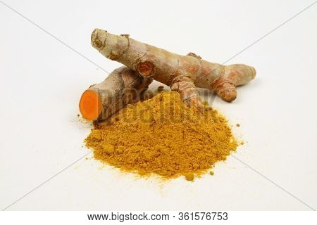 Turmeric Powder And Turmeric Root Extract Isolated On A White Background.it Is Used As A Tonic For T