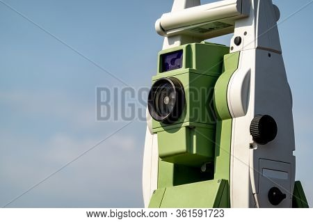 Geodetic Device. Electronic Total Station Close-up Against The Blue Sky. Selective Focus.