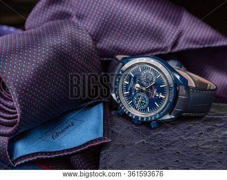Stylish Accessories For A Business Man. Expensive Wristwatch Close-up. A Luxurious Tie Is Rolled Up.