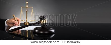 Judge Or Lawyer Hand Writing Court Litigation
