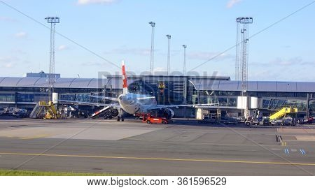 Copenhagen, Denmark - Jul 06th, 2015: Loading Airplane Parked By Copenhagen Airport Building, Stairs