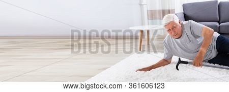 Fallen Senior Man On Carpet. Old Person Slip
