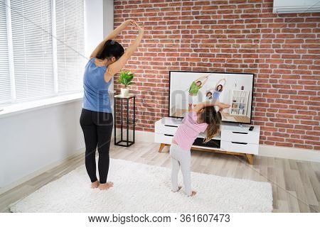 Fit Family Doing Home Online Yoga Fitness Exercise