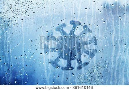 Coronavirus Molecule Figure Is Painted On Wet Blue Window With Raindrops Concept Photo Self-isolatio