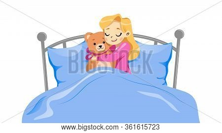 Concept Of Childhood. Young Happy Girl Lying With Teddy Bear In A Bed. Girl Is Hugging Toy Lying On
