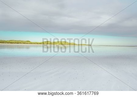 Northumberland Beach Landscape - Stretch Of Land Reflected In Calm Water