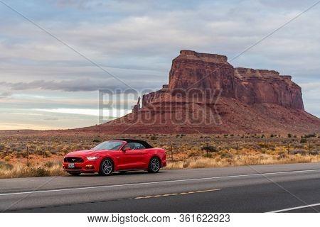 Monument Valley , Utah, Usa November 2017: Photo Of A Red Ford Mustang At Monument Valley, Utah, Usa