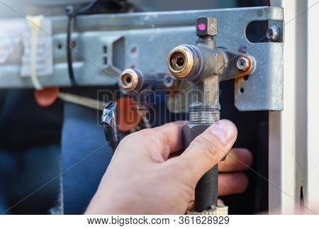 Air Conditioning Repair Man Hands Checking And Fixing Air Conditioning Service Valve, Technician Che